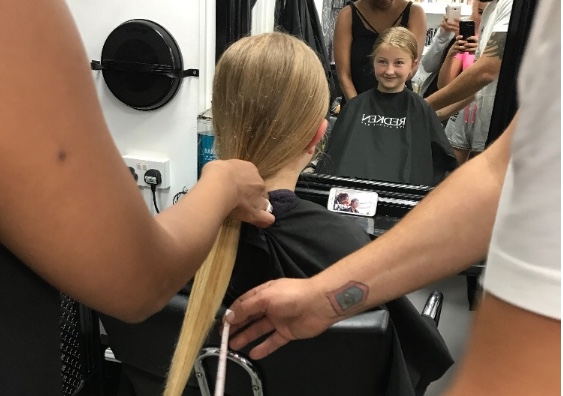 Evie is a cut above as she has her long hair cut for charity