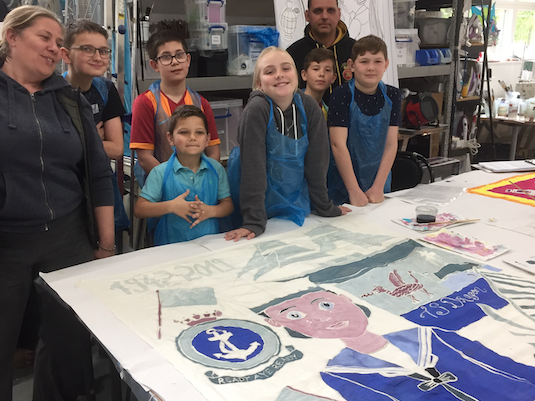 Kinetika work with Tilbury on the Thames Trust to create flags for the Tilbury carnival