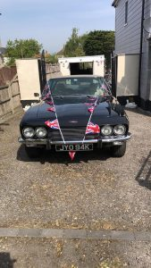 Jensen Interceptor decorated with VE Day flags.