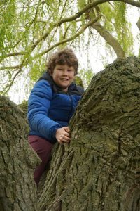 Ewan Lloyd completing his ten walk and tree climb