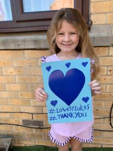 6-year-old Lilly (pictured) with her blue heart.